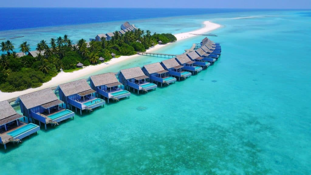row of water bungalows in the Indian Ocean